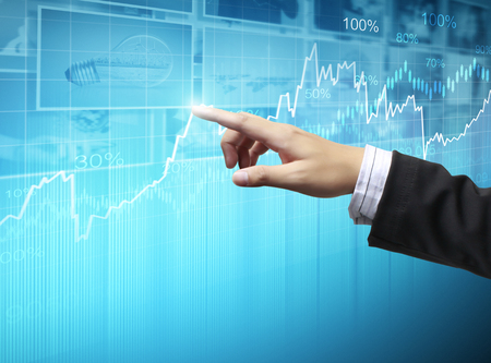 global market: businessman with financial symbols coming from han