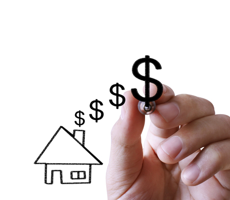 person writing: Businessman drawing a house Stock Photo