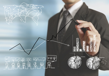 business concepts: Businessman drawing graphics a growing graph