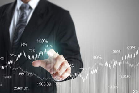 growth chart: businessman with financial symbols coming from han