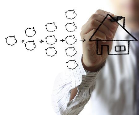 man writing: Businessman drawing a house Stock Photo