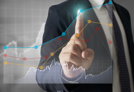global market: Businessman with financial symbols coming Stock Photo