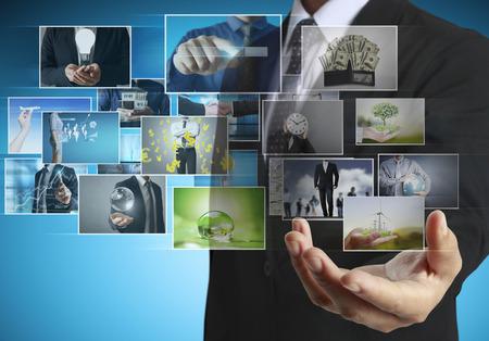 flat display panel: businessmen and Reaching images streaming, digital photo album