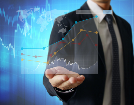 financial symbols: Businessman with financial symbols coming Stock Photo