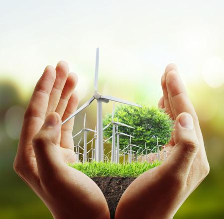 Eco macht, wind turbines in de hand Stockfoto