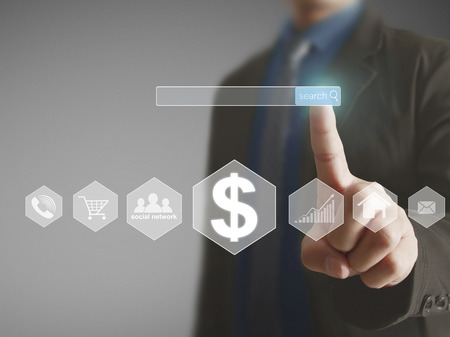 money background: Businessman with financial symbols coming Stock Photo