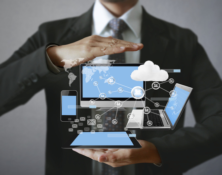 Technology in the hands of businessmen Imagens