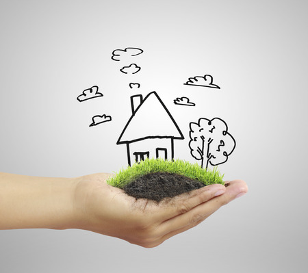 Business man house in human hands Stock Photo