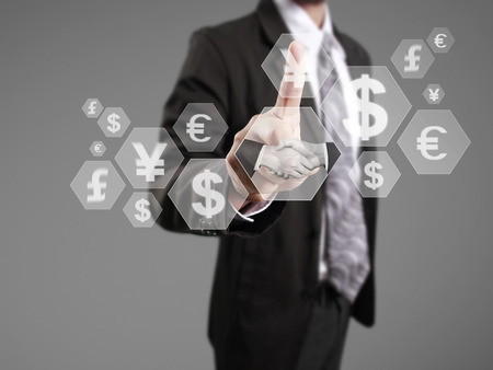 foreign exchange rates: businessman with financial symbols coming from han