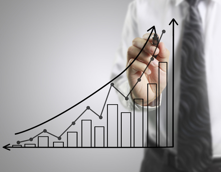 future earnings: Businessman drawing graphics a growing graph