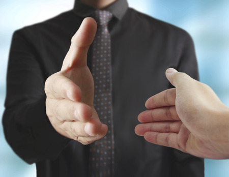 unrecognizable: Business handshake with business people