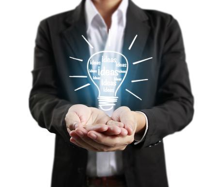 innovation concept: Hands of business person holding light bulb
