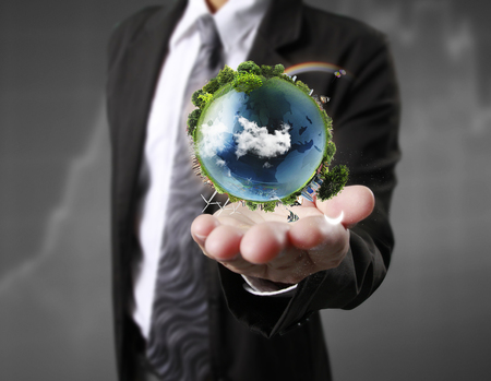 green world: Globe ,earth in human hand, hand holding our planet earth glowing