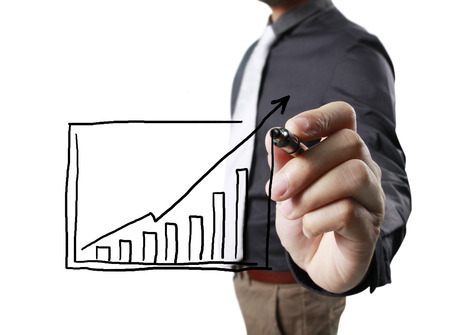 future earnings: Businessman drawing graphics  growing graph