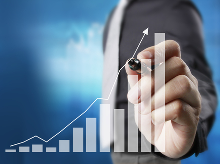business idea: Businessman drawing graphics a growing graph