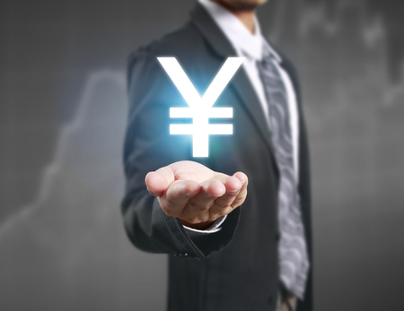 financial symbols: businessman with financial symbols coming from hand