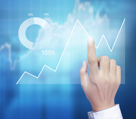 financial symbols coming from a hand Stock Photo