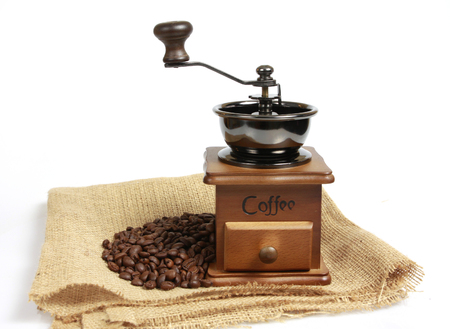 black textured background: Vintage coffee mill with coffee beans