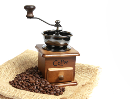 Vintage coffee mill with  coffee beans