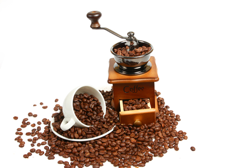 black textured background: Vintage coffee mill with coffee beans cup Stock Photo