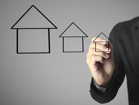 Hand drawing a house Standard-Bild - 109224556