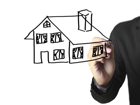 Hand drawing a house Standard-Bild - 109224553