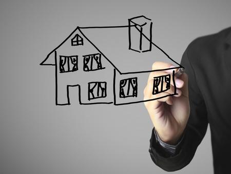 Hand drawing a house Standard-Bild - 109224555