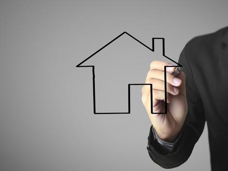 Hand drawing a house Standard-Bild - 109224560