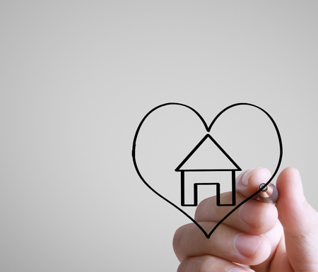 Hand drawing a house Standard-Bild - 109224359