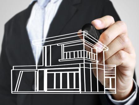 Hand drawing a house Standard-Bild - 109224363