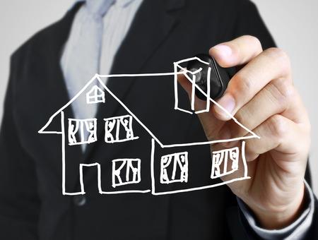 Hand drawing a house Standard-Bild - 109224371