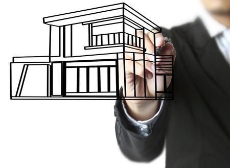 Hand drawing a house Standard-Bild - 109224374