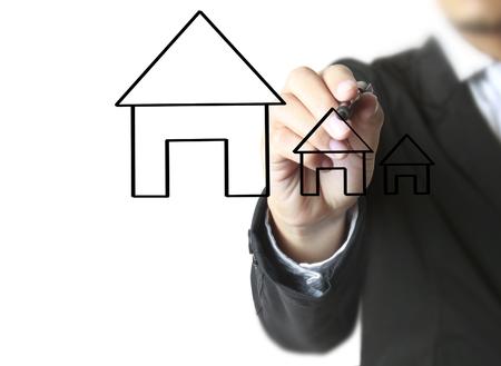 Hand drawing a house Standard-Bild - 103612669