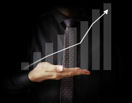 Businessman with financial symbols coming Standard-Bild - 103614827