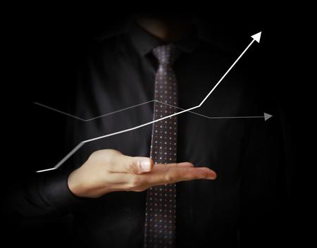 Businessman with financial symbols coming Standard-Bild - 103614794