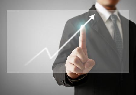 Businessman with financial symbols coming Standard-Bild - 103614795