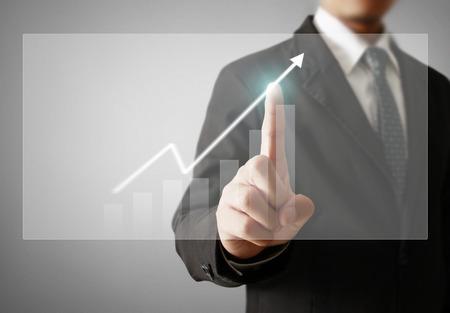 Businessman with financial symbols coming Standard-Bild - 103614796