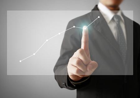 Businessman with financial symbols coming Standard-Bild - 103614801