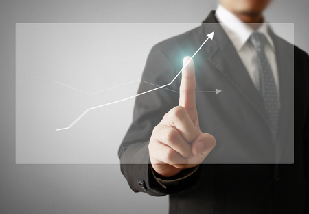 Businessman with financial symbols coming Standard-Bild - 103614804