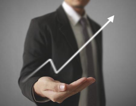 Businessman with financial symbols coming Standard-Bild - 103614805