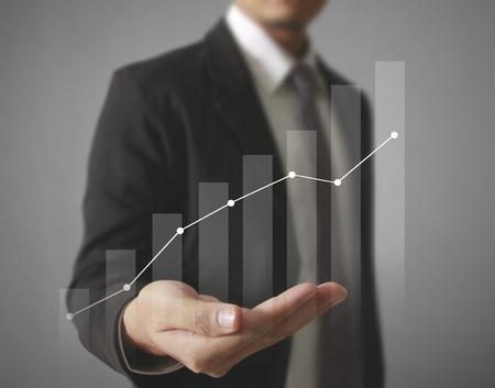 Businessman with financial symbols coming Standard-Bild - 103614812