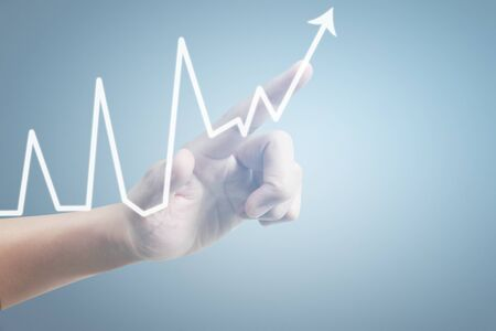 Hand touching a graphs of financial indicator and accounting market economy analysis chart Archivio Fotografico - 128751953