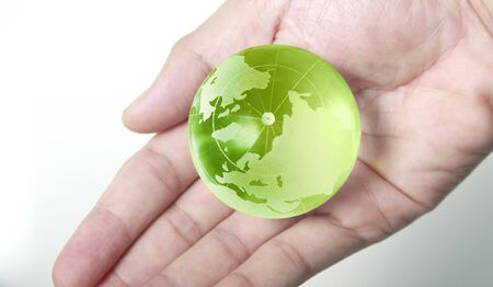 Globe  in human hand, holding our planet glowing. 免版税图像