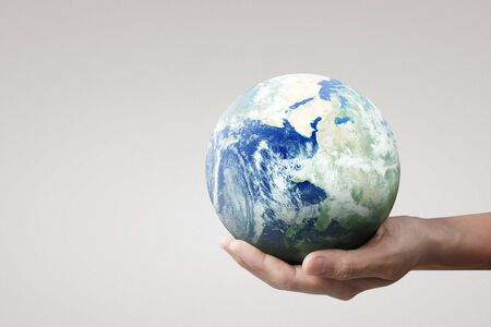 Globe ,earth in human hand, holding our planet glowing. Earth image provided by Nasa