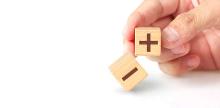 Concept creative idea and innovation. wooden cube block in hand with symbol