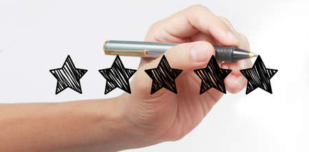 Hand drawing a five star rating on white