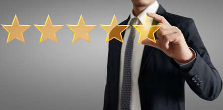 Hand of touching rise on increasing five stars. Increase rating evaluation and classification concept Stock Photo