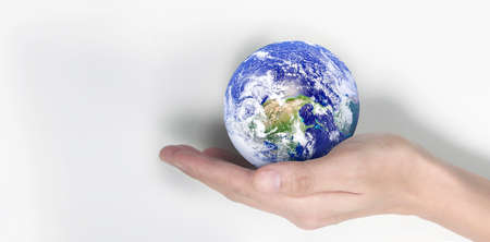 Globe ,earth in human hand, holding our planet glowing. Earth image provided by Nasa 版權商用圖片