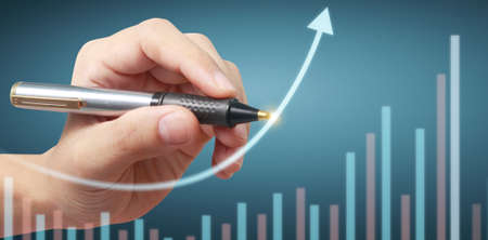 Hand drawing a chart. graph stock of growth