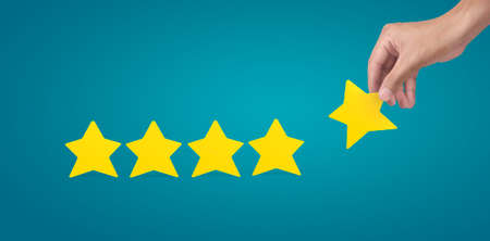 Stars in hand for rating evaluation and classification concept